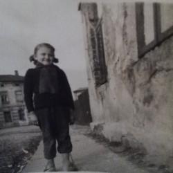 1, Bohaterów Getta Warszawskiego street. Bożena Harasimowicz (sister of Mirosława Harasimowicz) by the family house. 1950s